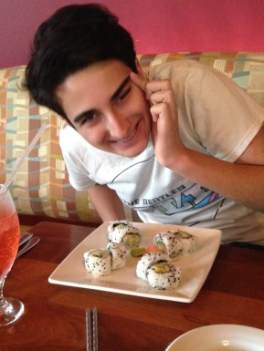 My middle son, who loves sushi and funny faces.