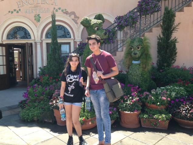 My little chicks being attacked by Disney topiary.