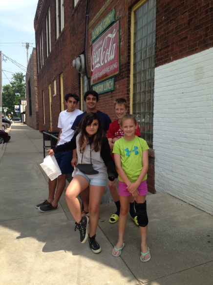 Cousins enjoying hand-made chocolates and old-fashioned phosphate sodas at the Olympia Bakery in Goshen, Indiana